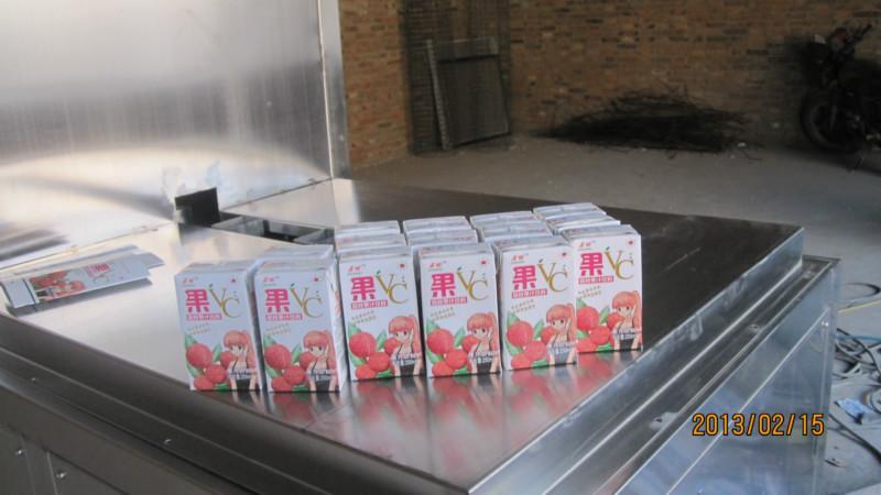 供应深圳果汁砖型纸盒包装机,新型自动果汁砖型纸盒包装机厂家直销